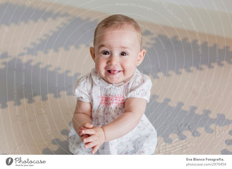 portrait of a beautiful baby girl at home. Family concept indoor Lifestyle Joy Happy Beautiful Face House (Residential Structure) Child Human being Feminine