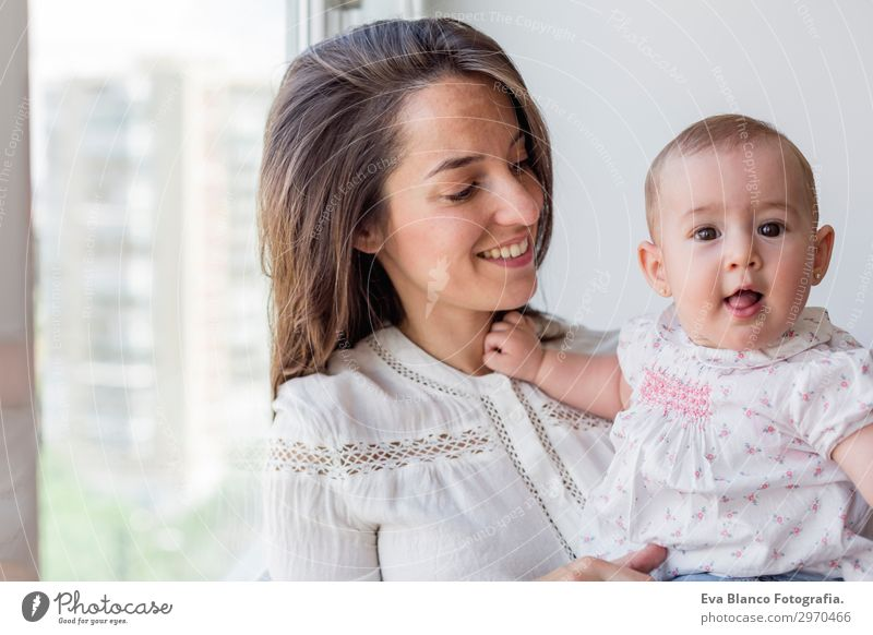 portrait of a beautiful baby girl and her mother at home Lifestyle Joy Happy Beautiful Face Playing Living or residing Flat (apartment)