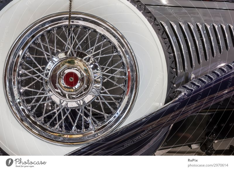 Spare wheel of a classic car. Lifestyle Luxury Elegant Style Leisure and hobbies Motorsports Work and employment Workplace Industry Art Work of art Transport