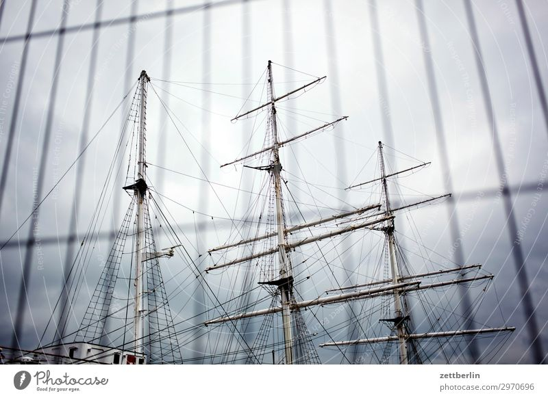 Gorch Fock in Stralsund Watercraft Sailboat Sailing ship Pole Mast Yardarm Museum Fence Sky Heaven Deserted Copy Space Old Ancient Harbour Hanseatic League