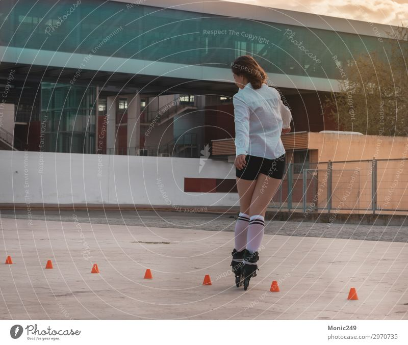 Beautiful young woman having fun with roller skates Lifestyle Style Joy Happy Leisure and hobbies Freedom Sports Human being Feminine Young woman