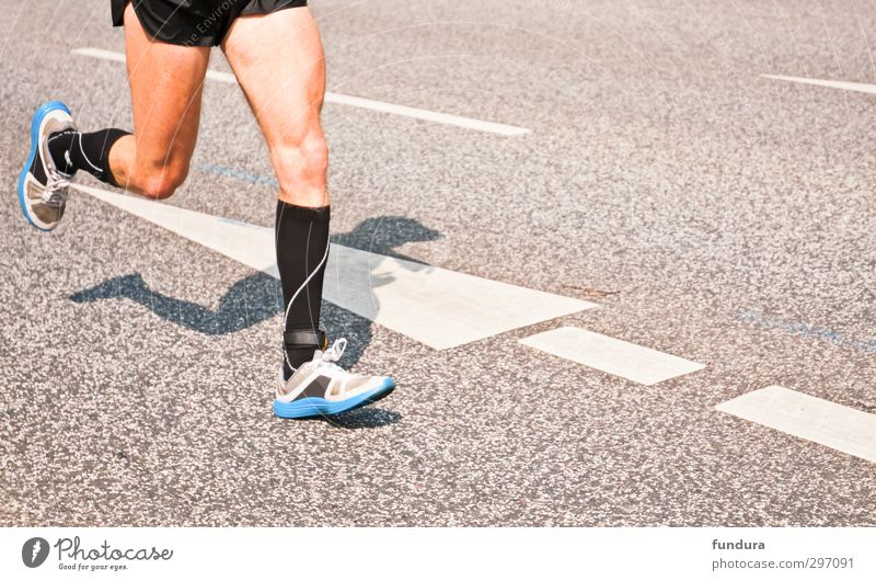 Marathon runner on asphalt. Healthy Athletic Fitness Life Sports Sportsperson Sporting event Jogging Masculine Man Adults Legs 1 Human being 18 - 30 years