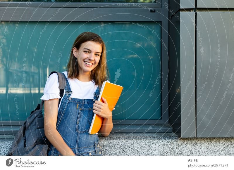 Happy student girl portrait Lifestyle Beautiful School Academic studies Woman Adults Youth (Young adults) Brunette Smiling Laughter Stand Cute Blue teenager
