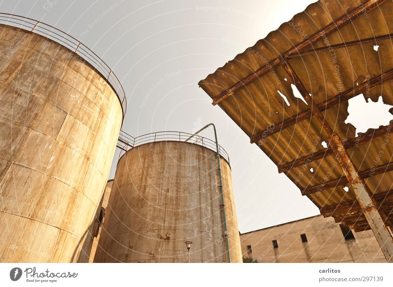old, crooked and broken .... Cloudless sky Summer Warmth Industrial plant Factory Manmade structures Facade Roof Old Silo Tank Storehouse Corrugated sheet iron