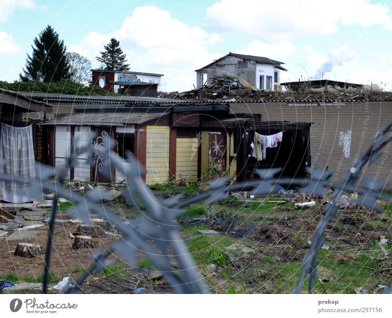 House (Residential Structure) Life Sadness Freedom Poverty Living or residing Gloomy Fence Decline Skyline Society Barrier Chaos Laundry Ruin Destruction