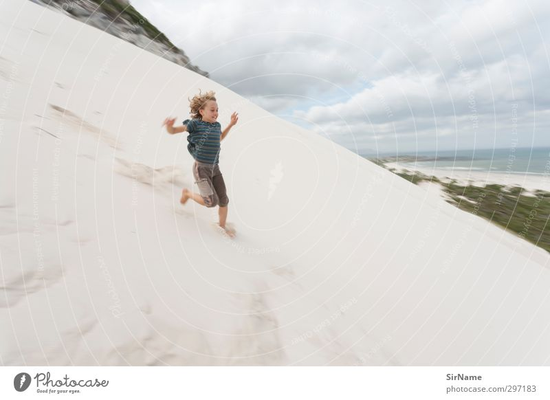 Human being Child Nature Vacation & Travel Landscape Clouds Beach Far-off places Life Boy (child) Freedom Happy Coast Sand Horizon Rock