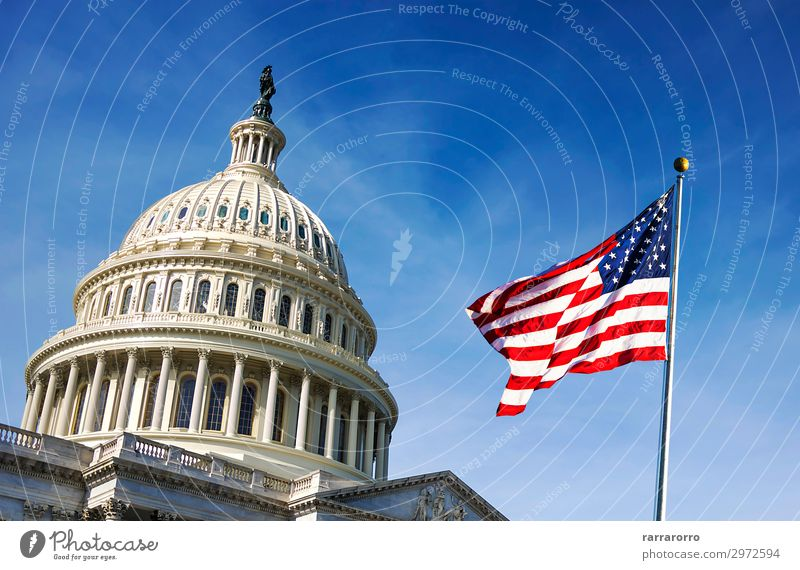 American flag waving with the Capitol Hill Vacation & Travel Tourism Sky Architecture Facade Monument Stripe Flag Historic Blue White Politics and state USA