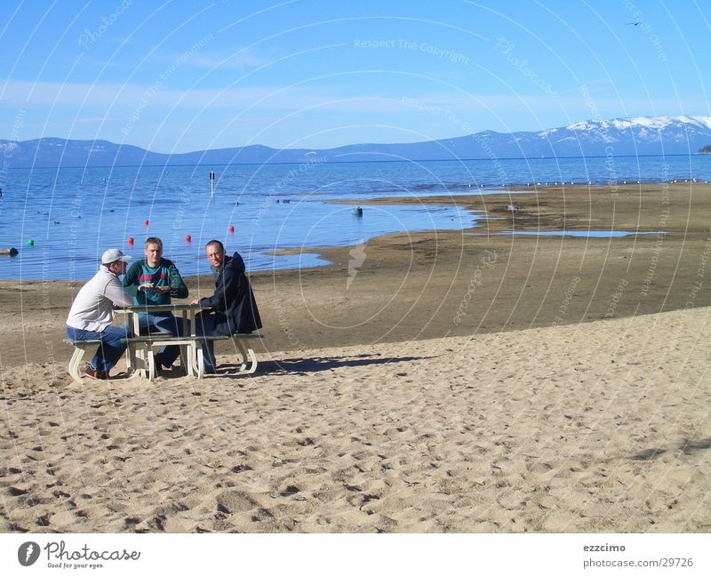 There was a bank on the beach. Beach Lake California Nevada Bench Sit Water lake tahoe USA Lakeside Sand Sandy beach Vacation photo Far-off places Tourist