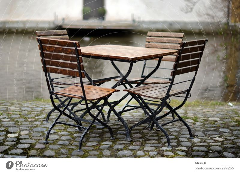 seating group To have a coffee Chair Table Restaurant Sit Garden chair Café Free Empty Outdoor furniture Sidewalk café Colour photo Exterior shot Deserted