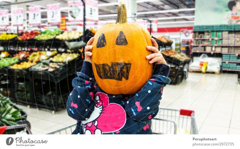 Little girl holding a pumpkin in her hands, on Halloween. Vegetable Joy Happy Decoration Feasts & Celebrations Hallowe'en Child Human being Woman Adults Infancy