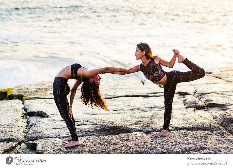 Two girls on the beach doing yoga at sunset. Lima Peru. Lifestyle Happy Beautiful Body Wellness Relaxation Summer Sun Beach Ocean Sports Yoga Human being Woman