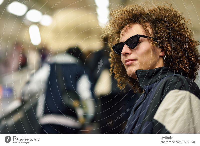 Young man going upstairs at a subway station. Lifestyle Style Hair and hairstyles Vacation & Travel Trip Human being Masculine Youth (Young adults) Woman Adults