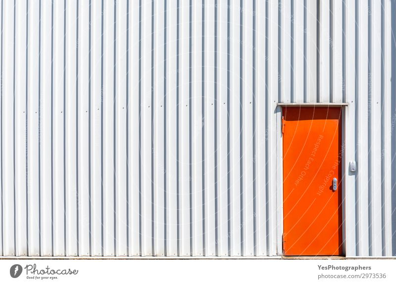 Orange metal door and a white warehouse wall Factory Industry Business Building Architecture Facade Metal Steel Modern White Access aluminum background closed