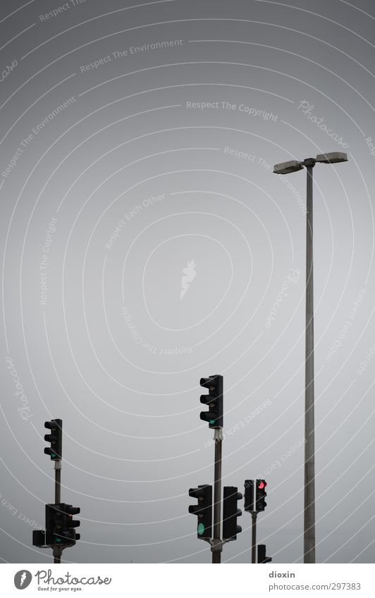 rømø | traffic lights Sky Bad weather Transport Crossroads Traffic light Lamp post Street lighting Driving Wait Gray Town Colour photo Exterior shot Deserted