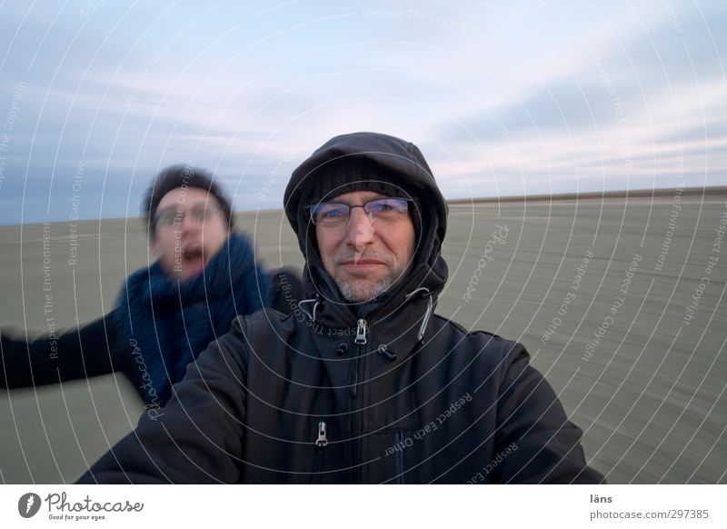 Rømø | Roundabout Beach Human being Man Adults 2 Sky Horizon Sand Movement Rotate Speed Ease Exterior shot Evening Wide angle Upper body Looking into the camera