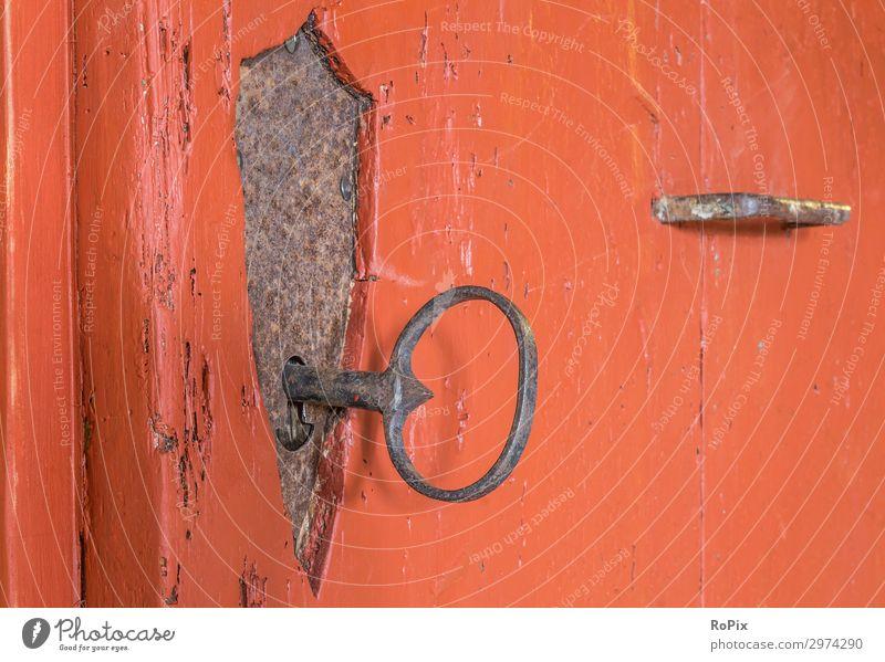 Wrought-iron castle in a historical door. Door lock ornaments Knocker door handle door fitting built House (Residential Structure) wood oak wood Iron Old