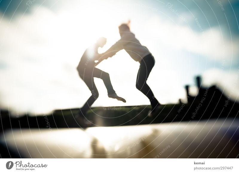 Human being Youth (Young adults) Young woman Adults Young man Life Sports Feminine Playing 18 - 30 years Legs Couple Jump Friendship Body Masculine