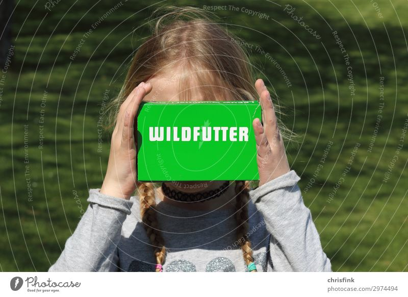 Child holds box of wild food Human being Feminine Girl Body 1 8 - 13 years Infancy Park Animal Feeding Green Joy Zoo Wild Colour photo Exterior shot Day
