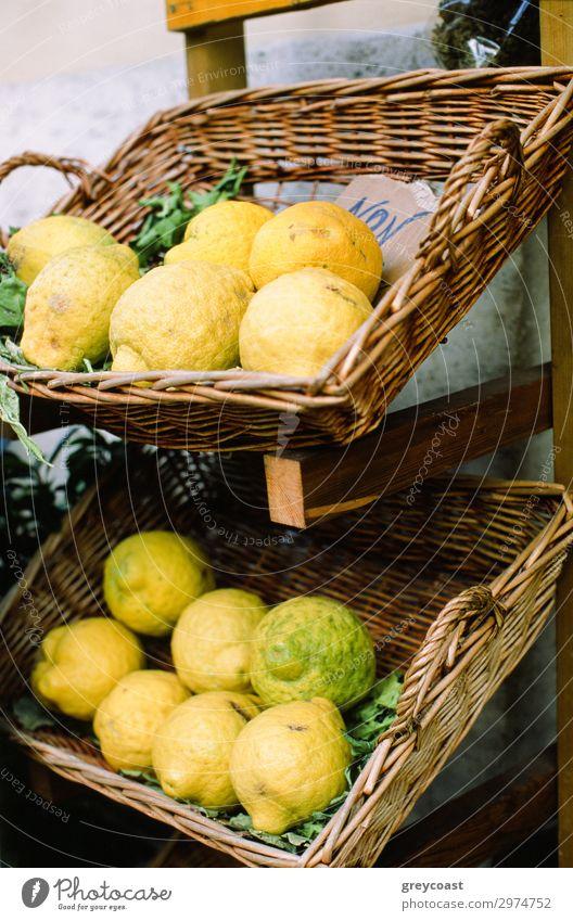 Fresh lemons in flat buskets, placed on a rack Fruit Yellow Lemon citrus Napoli Italy Basket market mart Crate no person Still Life Mature Vertical Colour photo