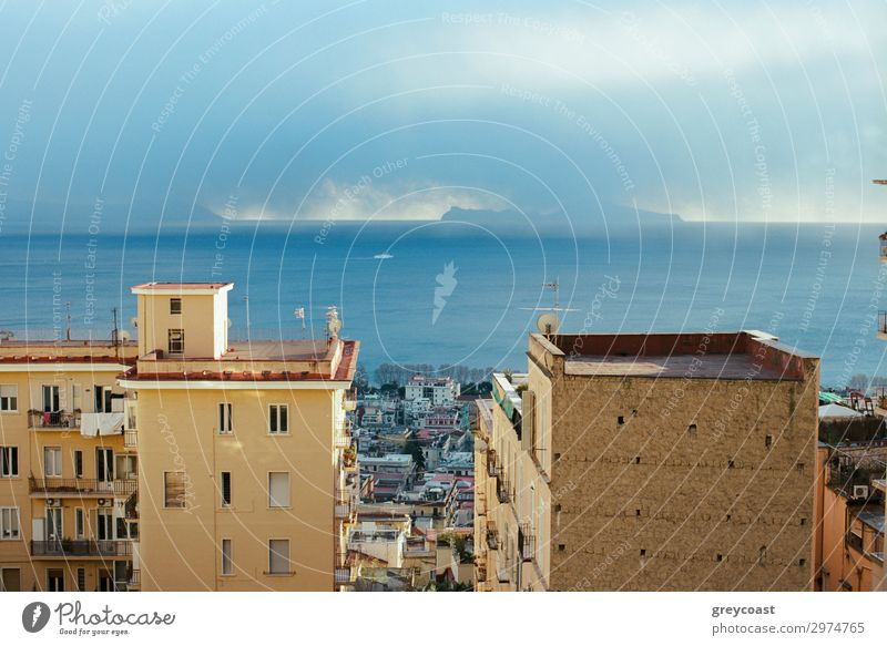 Picturesque scene of Naples, Italy. Clouds over the sea and city coast with houses Ocean House (Residential Structure) Sky Coast Town Building Architecture