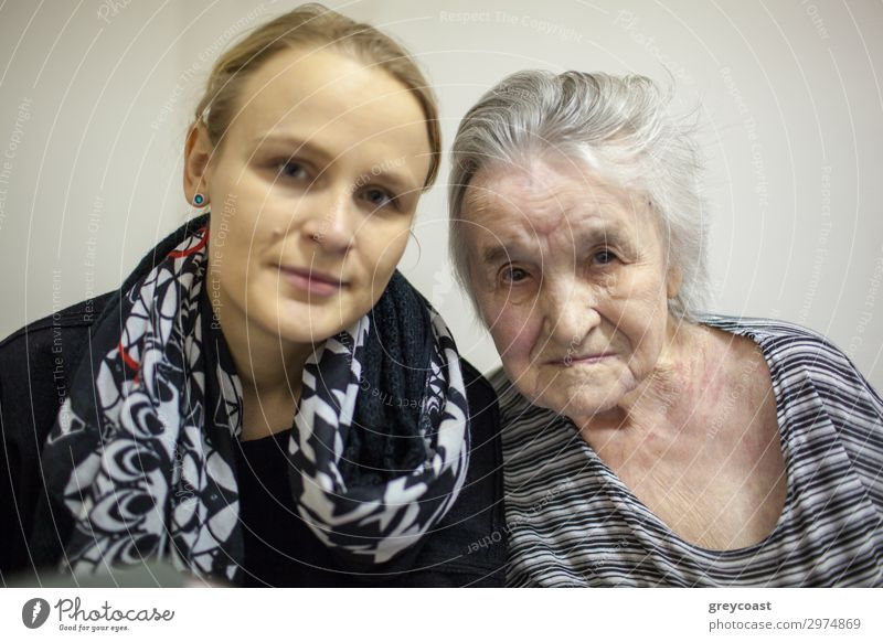 A double portrait of a young woman and her grand mother Life Human being Feminine Young woman Youth (Young adults) Woman Adults Female senior Grandmother