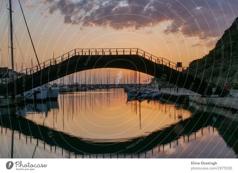 Beautiful view on bridge in Medieval town of Castelsardo at sunset, Province of Sassari, Sardinia, Italy. Colorful photo of gorgeous italian town. Popular travel destination. Mediterranean seacoast.