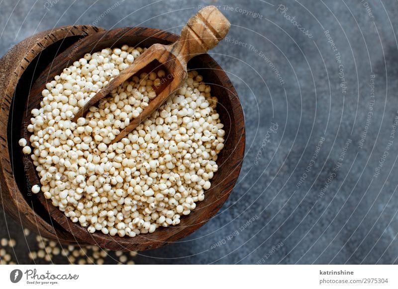 Raw White Sorghum grain Vegetable Vegetarian diet Diet Bowl Spoon Natural Gray Cereal Copy Space seed Rustic wood Vegan diet Dried fiber food gluten free health