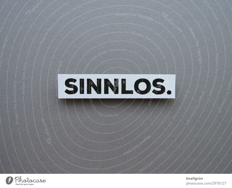 SINNLOS. Characters Signs and labeling Communicate Gray Black White Emotions Sadness Senses Futile Free of charge Useless Cheap superfluous Colour photo