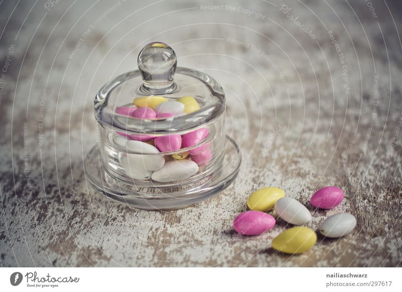 sweet sin Food Dessert Candy Chocolate Nut sugared almond Bowl Glass To enjoy Delicious Natural Positive Round Beautiful Sweet Multicoloured Yellow Gray Pink