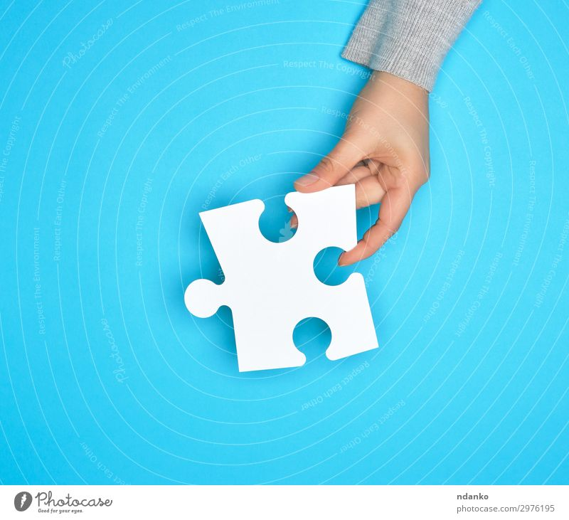 female hand holding white empty paper puzzle Playing Work and employment Business Hand Blue White Colour Idea Creativity Crisis Teamwork people