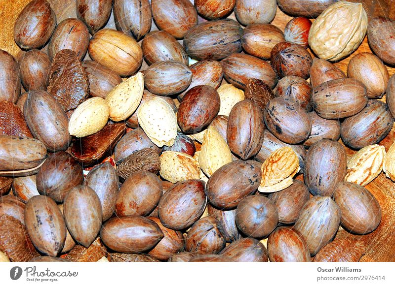Mixed nuts in shells. Nut Raw Healthy Eating Nutrition Food Brown Walnut Almond cashews Energy Organic Crunchy Snack