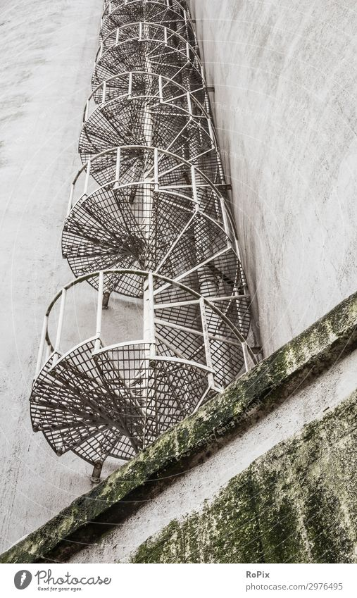 Fire escape staircase on a bunker building. Nature Old Architecture Environment Facade Work and employment Design Stairs Metal High-rise Technology Industry