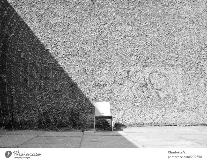 chair Wall (barrier) Wall (building) Chair Concrete Wood Characters Graffiti Stand Simple Retro Gray Black White Calm Authentic Unwavering Modest Curiosity