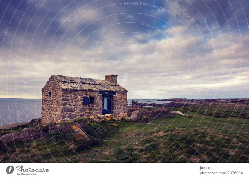 Stone house on a steep coast with cloudy sky and sea House (Residential Structure) Ocean Clouds Brittany stone house door Entrance Window wide forsake sb./sth.