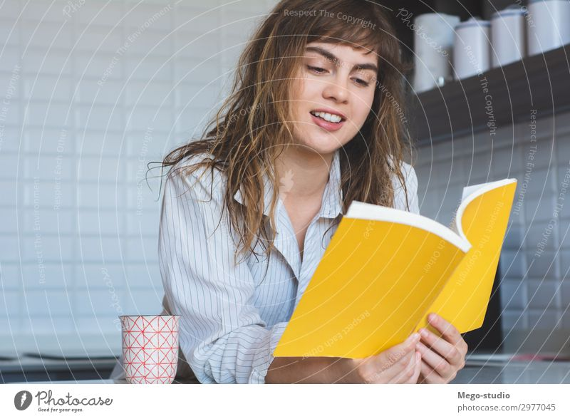woman reading a book Breakfast Lifestyle Joy Happy Beautiful Relaxation Reading House (Residential Structure) Table Kitchen Human being Woman Adults Book Think