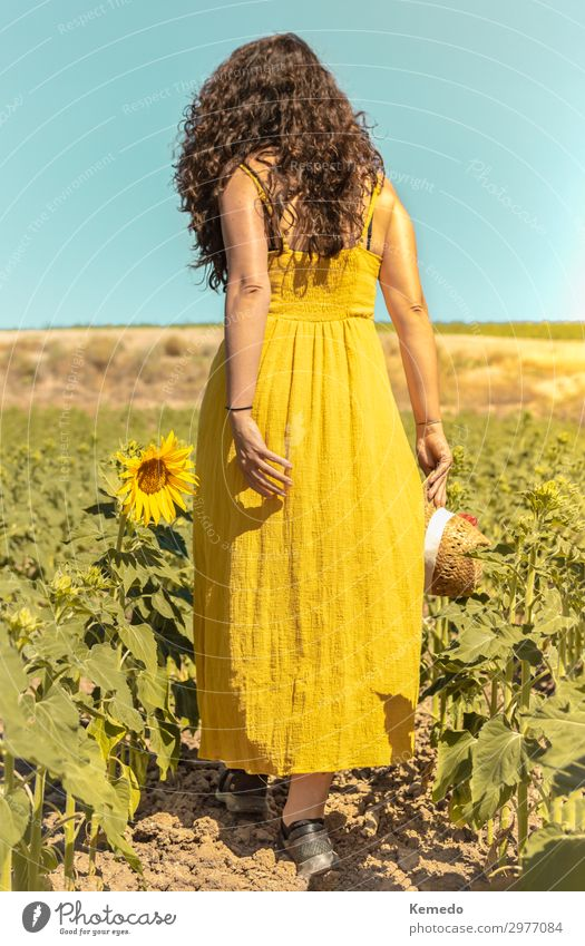 Young woman with yellow dress and hat walks in the countryside. Woman Human being Sky Vacation & Travel Nature Youth (Young adults) Summer Plant Blue Colour