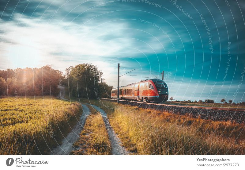 High-speed train moving through nature at sunset Vacation & Travel Summer Industry Technology Nature Landscape Sky Autumn Meadow Transport Public transit
