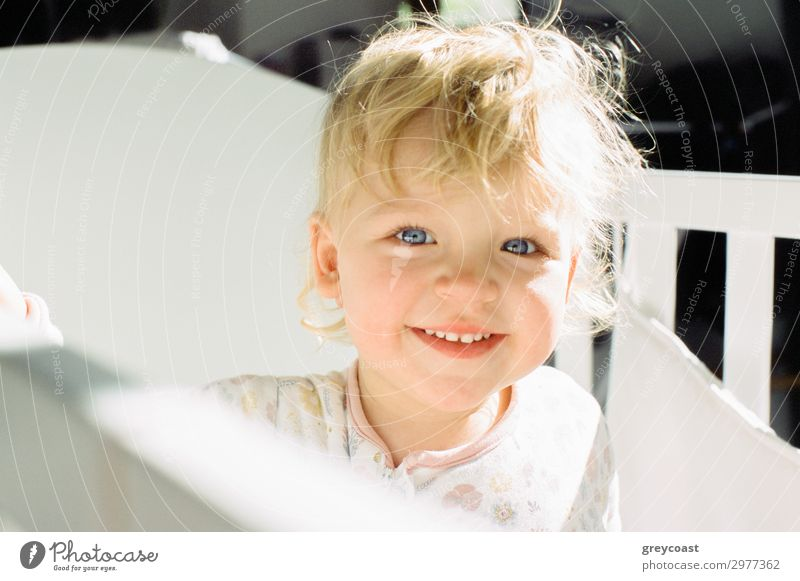 Portrait of a smiling baby girl in her cot Joy Bed Child Human being Feminine Baby Girl Infancy 1 0 - 12 months Blonde Smiling Happiness Daughter baby blond