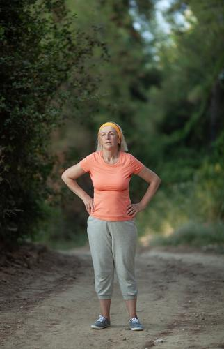 After a jog Sports Human being Feminine Woman Adults Female senior 1 45 - 60 years Park Fitness Running Fatigue Middle-aged one Caucasian Breath Hand on hip run