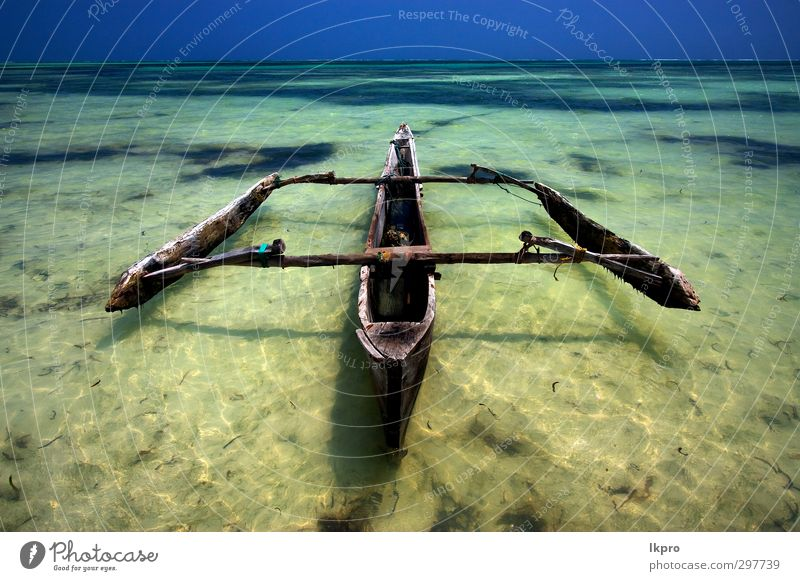 a boat in the sea of Madagascar Nature Blue Vacation & Travel Water Sun Ocean Landscape Beach Wood Watercraft Tourism Trip Adventure Dive Bay Wooden board