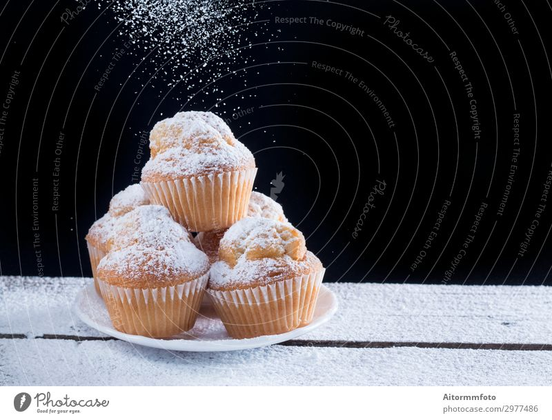 Pourting sugar on Cupcakes Cake Dessert Breakfast Plate Table Feasts & Celebrations Birthday Group Paper Wood Fresh Small Delicious Brown Red Home-made