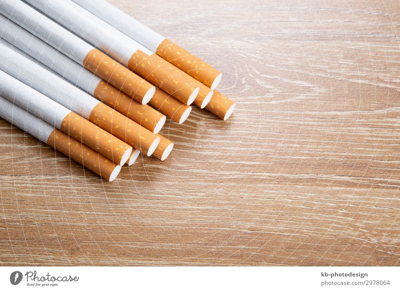 Cigarettes on a wooden background Lifestyle Smoking cigarette cigarettes ash tobacco nicotine smoke dependence pollutants dependent health healthy sick illness