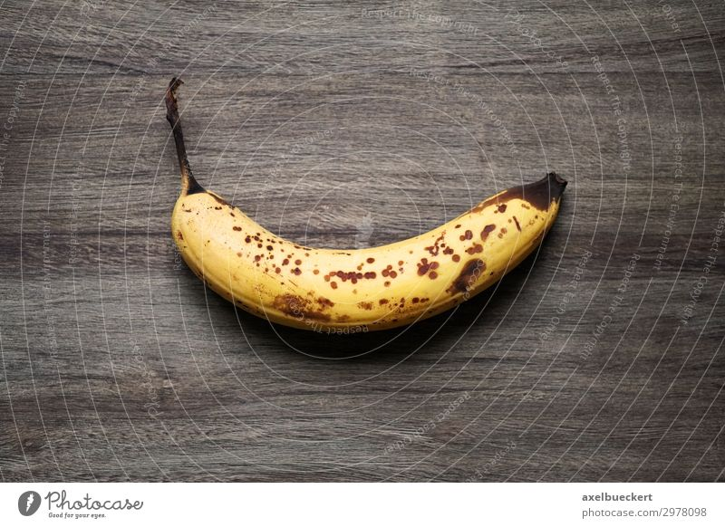 overripe banana on rustic wood background Food Fruit Nutrition Vegetarian diet Healthy Eating Old Brown Yellow Snack Banana Mature Patch Wood Wooden table
