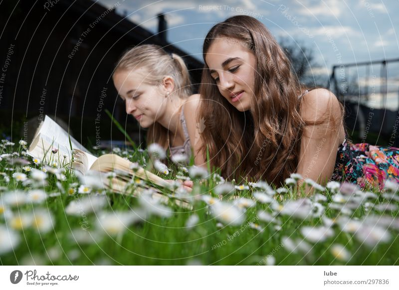 Reading in the green grass Contentment Education Study Human being Feminine Girl Brothers and sisters Youth (Young adults) 2 13 - 18 years Child Book Grass
