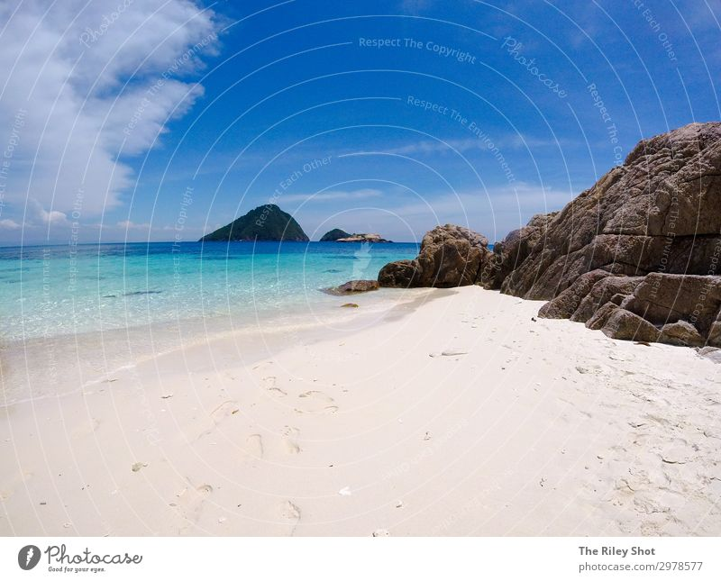 A view of a isolated beach and blue waters Beautiful Relaxation Vacation & Travel Tourism Adventure Summer Beach Ocean Island Nature Landscape Sand Sky Clouds