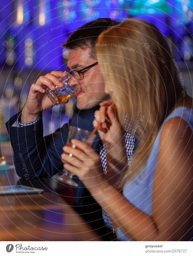 Young man and woman relaxing in the bar and having drinks. Nightlife and hanging out Beverage Alcoholic drinks Relaxation Night life Restaurant Club Disco