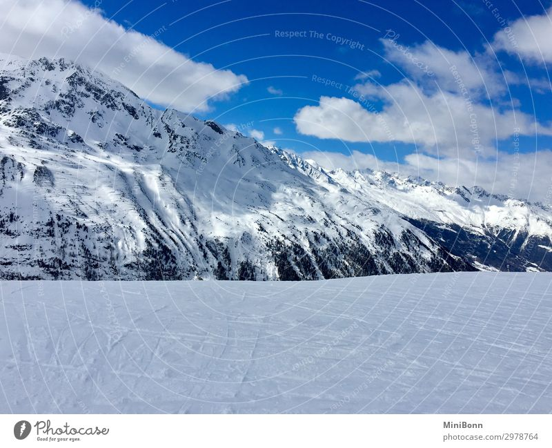 Snow-covered mountains Calm Winter Winter vacation Mountain Winter sports Skiing Snowboard Nature Sky Clouds Alps Peak Snowcapped peak Austria Relaxation Cold