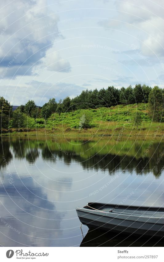 Peace and quiet by the lake in Scotland Lake boat Lakeside tranquillity silent Water grey-blue Blue Romance Peaceful Calm Gray Loneliness Idyll idyllically