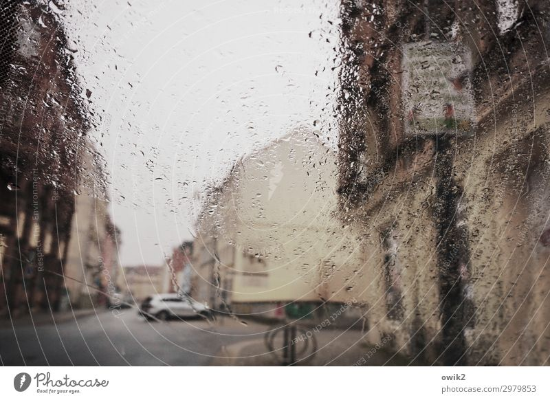 by the rain Water Drops of water Clouds Bad weather Rain Small Town Populated House (Residential Structure) Wall (barrier) Wall (building) Facade Street Car Wet
