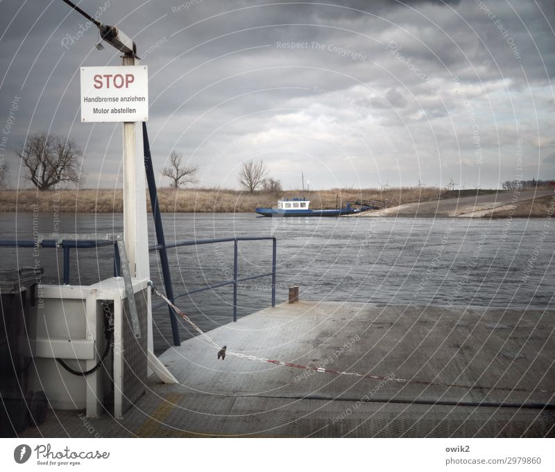 Ferry near Prettin Winter River Navigation Handrail Sign Characters Signs and labeling Signage Warning sign Dark Simple Gloomy Sadness Concern Grief Stagnating
